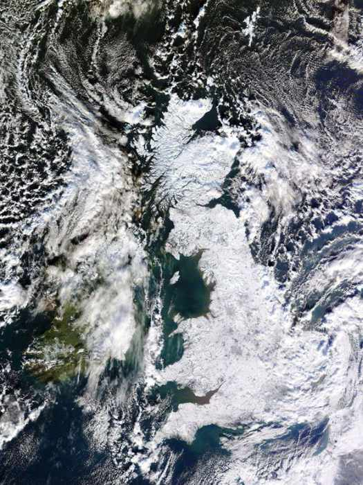 Satellite Image of a snow-covered UK (Source NASA)